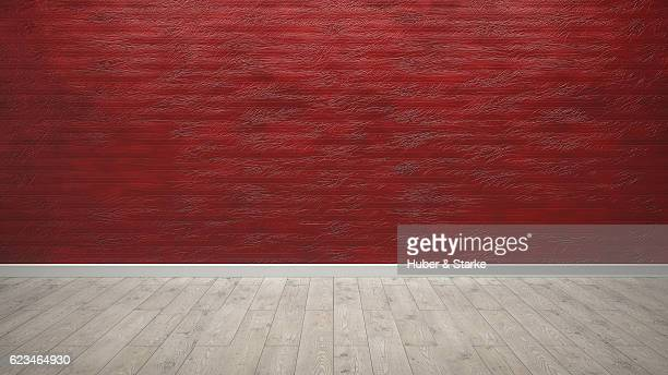 Empty room with modern red wall and wooden floor