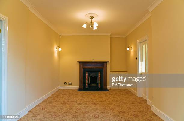 Empty room with open Victorian fireplace