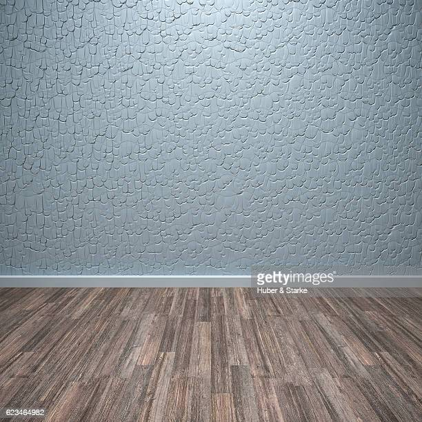 Empty room with silver blue patterned wall and wooden floor