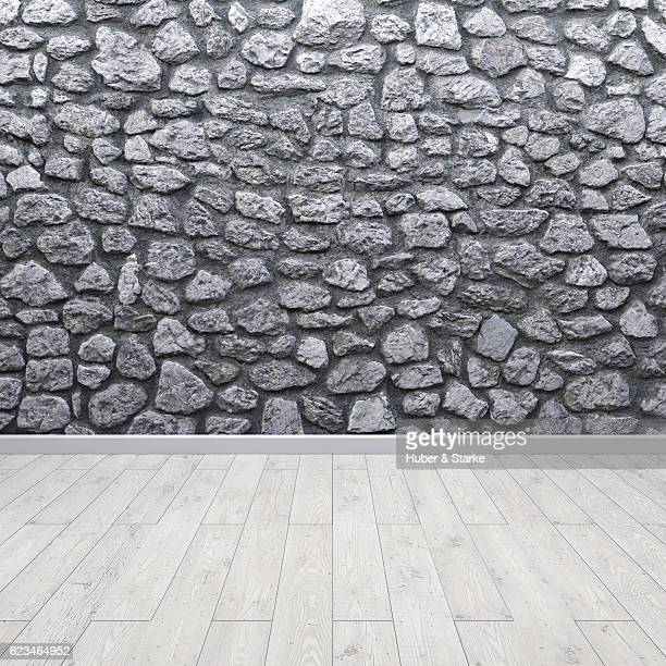 Empty room with stone wall and wooden floor