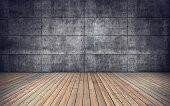 Empty room with wooden floor and concrete tiles wall background