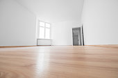 empty room - white walls and wooden floor in new apartment