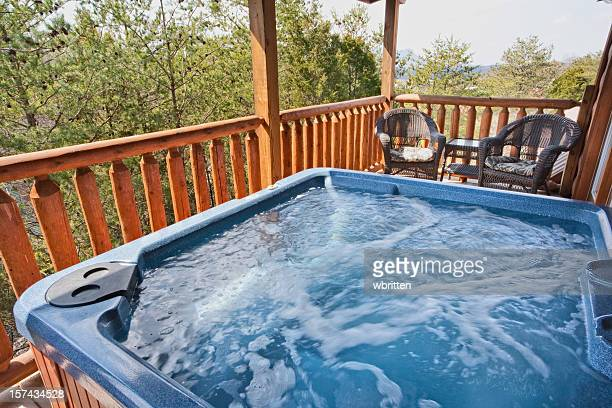 A empty running hot tub on the balcony