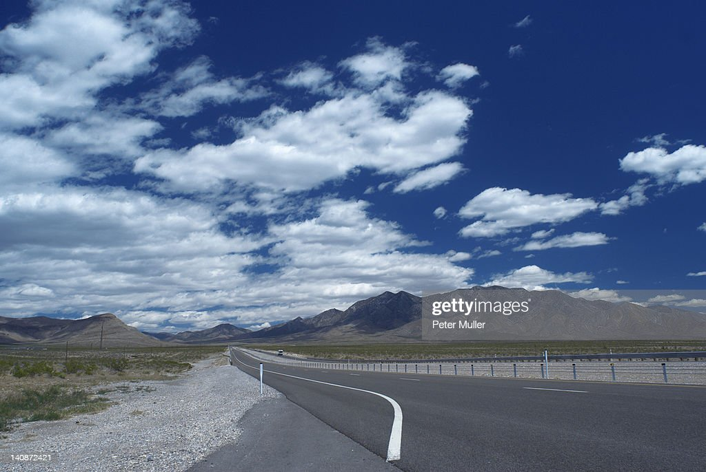 Empty rural road under cloudy sky : Stock Photo