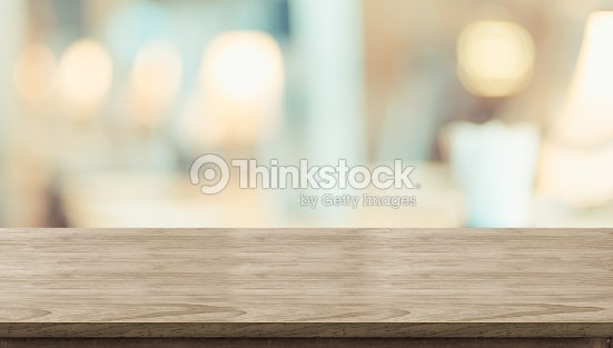 Empty rustic wood table and blurred soft light table in restaurant with bokeh background. product display template.Business presentation. : Stock Photo