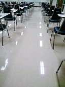 Empty Seating Desks With Chairs In Classroom