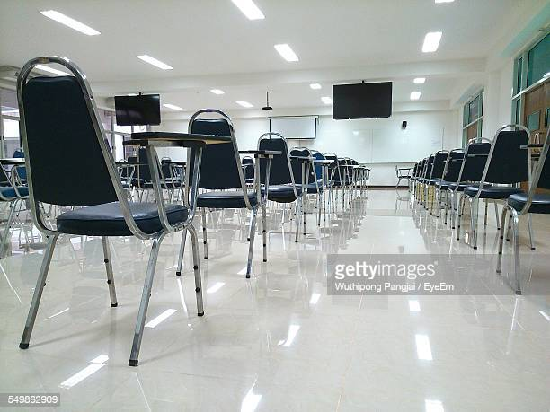 Empty Seating Desks With Chairs In Lecture Hall