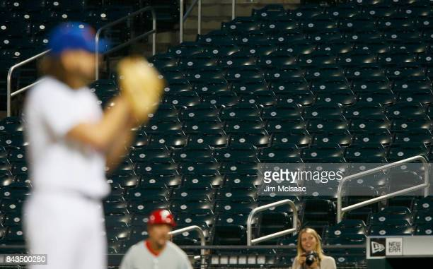 Empty seats are seen as Robert Gsellman of the New York Mets prepares to throw his first pitch of a game against the Philadelphia Phillies at Citi...