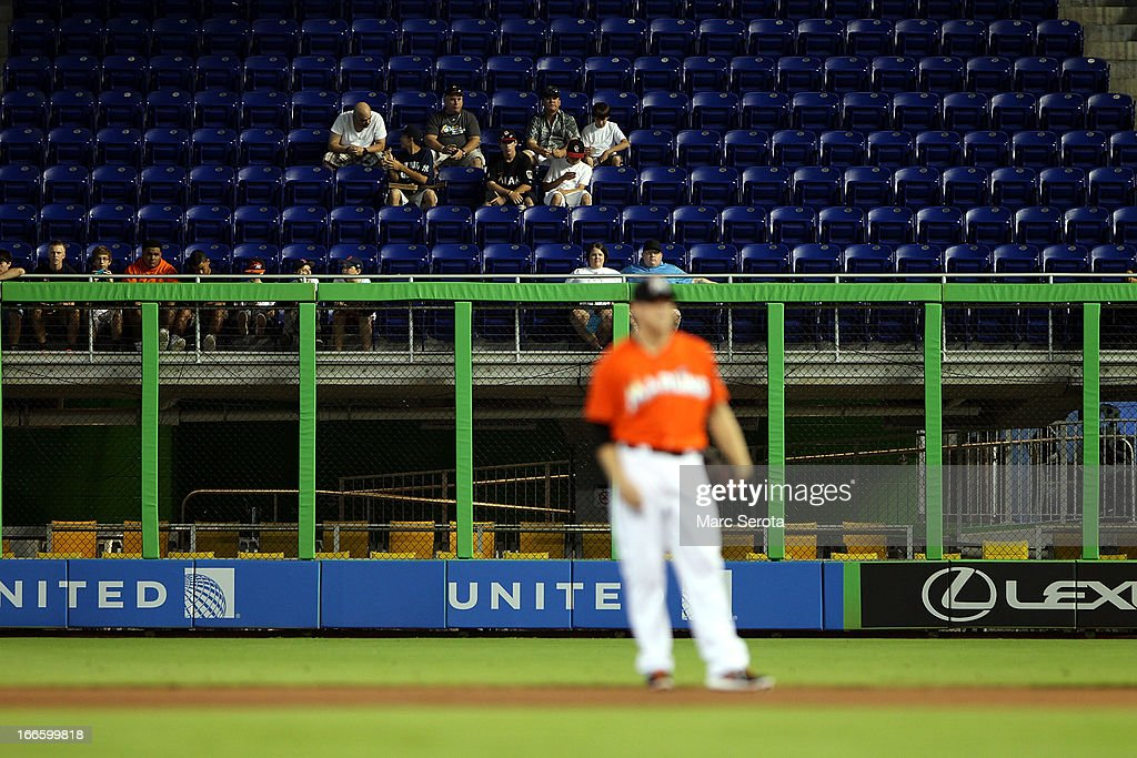 Empty seats are seen as the Philadelphia Phillies play against the Miami Marlins in the first inning at Marlins Park on April 14, 2013 in Miami, Florida.