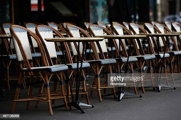 Empty seats are seen at a cafe during lunch time in Paris France on Saturday Nov 14 2015 French President Francois Hollande blamed Islamic State...