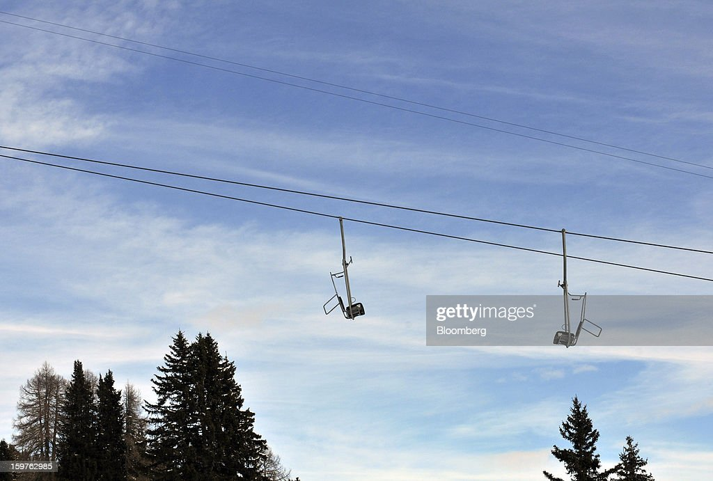 Empty seats are seen on the Schatzalp chair lift as it moves down the mountain in the town of Davos, Switzerland, on Saturday, Jan. 19, 2013. Next week the business elite gathers in the Swiss Alps for the 43rd annual meeting of the World Economic Forum in Davos, the five day event runs from Jan. 23-27. Photographer: Bryn Colton/Bloomberg via Getty Images