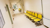 Empty yellow waiting seats in a hospital hallway