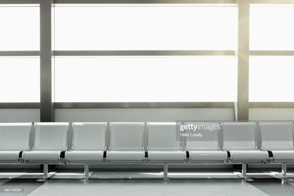 Empty seats in airport lobby