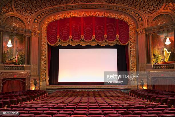 Empty seats in ornate movie theater