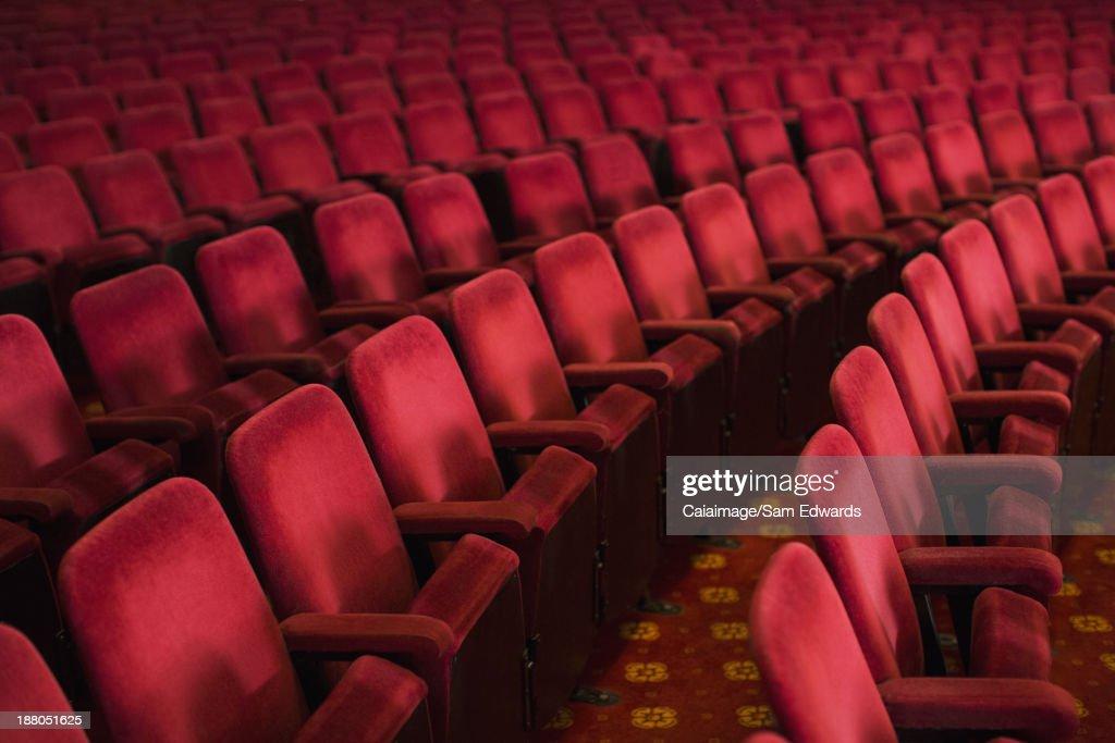 Empty seats in theater auditorium : Stock Photo