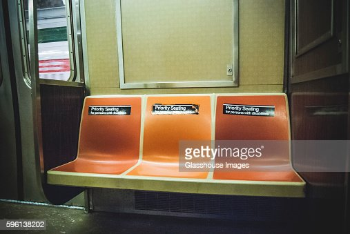 empty seats on subway car with priority seating stickers new york city usa stock photo getty. Black Bedroom Furniture Sets. Home Design Ideas