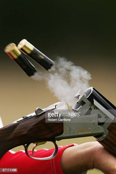 Empty shells eject from the shotgun of Christopher Simon Dean of England during the Men's Trap Pairs on Day Two of the 18th Commonwealth Games at the...