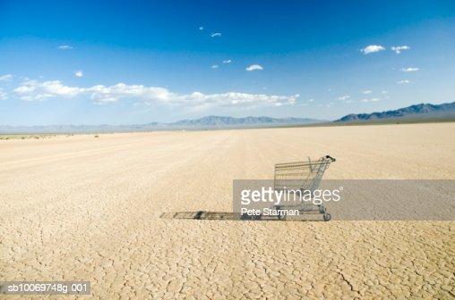 Empty shopping cart in desert