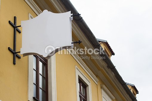 Empty signboard on a building with classical architecture