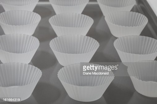 Empty silicone baking cups on a baking tray