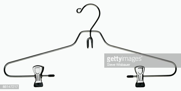 Empty silver metal wire clothes hanger with clips : Stock Photo