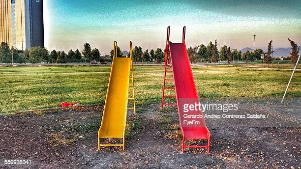 Empty Slides In Playground Against Sky