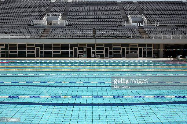 Empty spectator seats are seen above one of the outside swimming pools which form part of the Olympic Aquatic Centre at the Athens Olympic Sports...