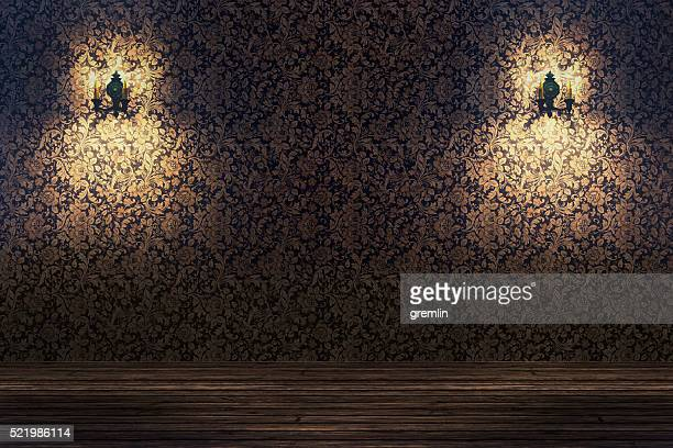 Empty spotlit room with flower pattern wallpaper