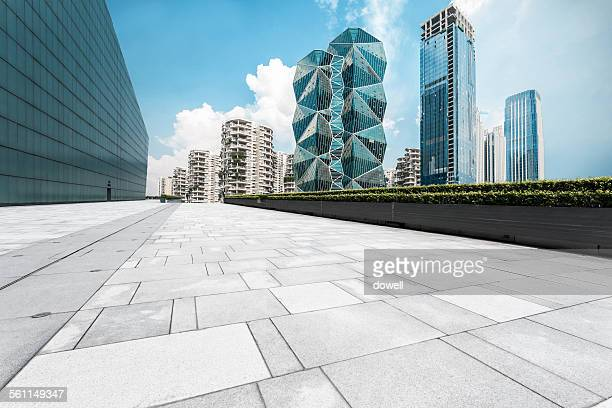 Empty square and modern skyline
