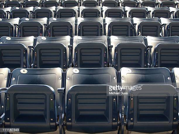 Empty stadium seats full frame with no people
