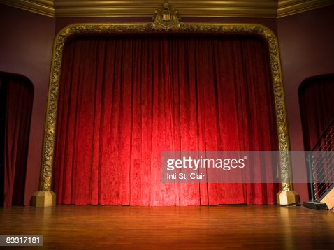 Empty stage with curtains closed and spotlight on : Stock Photo