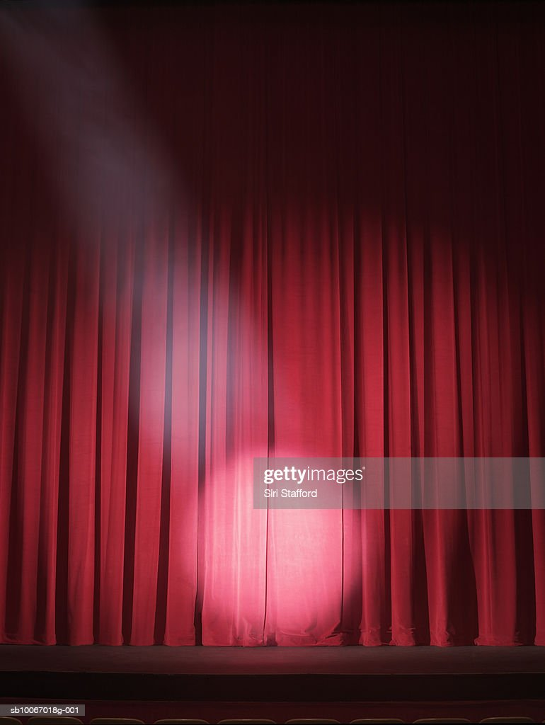 Closed theater curtains - Empty Stage With Curtains Closed And Spotlight On Stock Photo