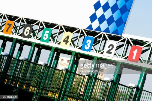 Empty starting gates at the horseracing track : Stock Photo
