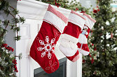 Empty Stockings Hung On Fireplace On Christmas Eve