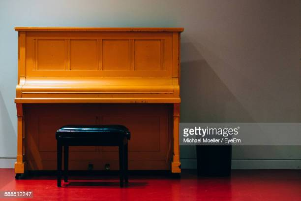 Empty Stool In Front Of Piano Table At Home