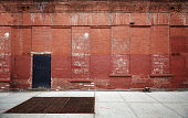 Empty street with old warehouse brick wall, industrial background, New York, USA.