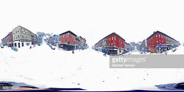 Empty streets are seen in blizzardlike conditions on January 23 2016 in the Brooklyn borough of New York City The Northeast and parts of the South...