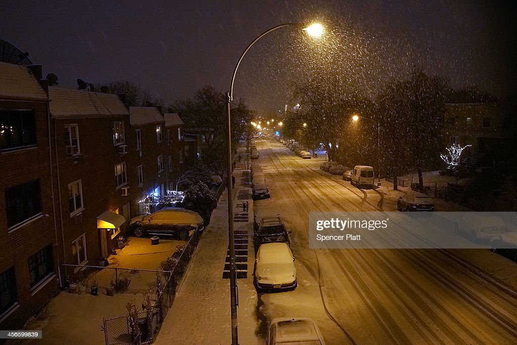 Empty streets are viewed during a snow storm on December 14, 2013 in the Brooklyn borough of New York, United States. Much of the Northeast was hit Saturday by a storm stretching over 1,000 miles that could result in at least a foot of snow on parts of New England.