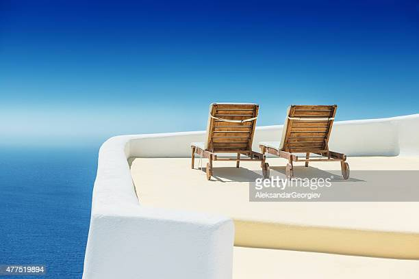 Empty Sun Lounge Chair on balcony In Santorini at Sunrise