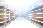 Perspective view of a shopping aisle with empty shelves in motion blur