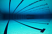 Wide angle of an empty olympic swimming pool underwater.