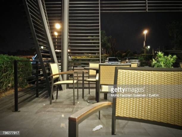 Empty Table And Chairs At Night