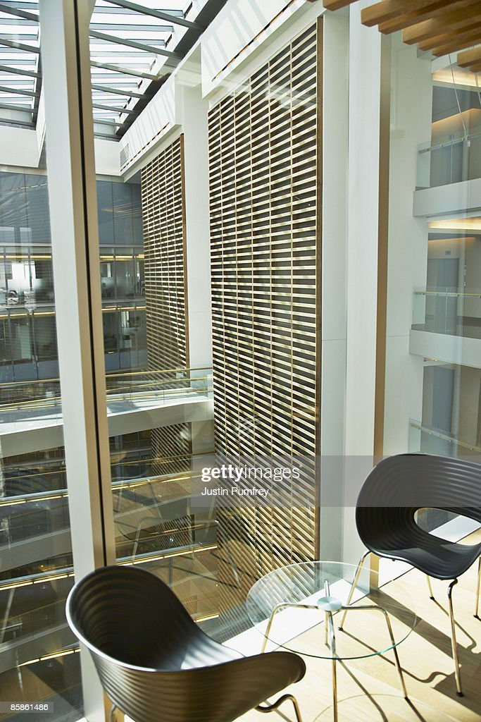 Empty table and chairs in modern office : Stock Photo