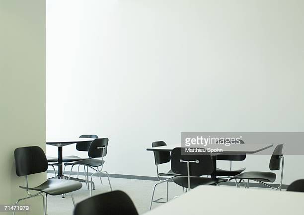 Empty table and chairs in office break room