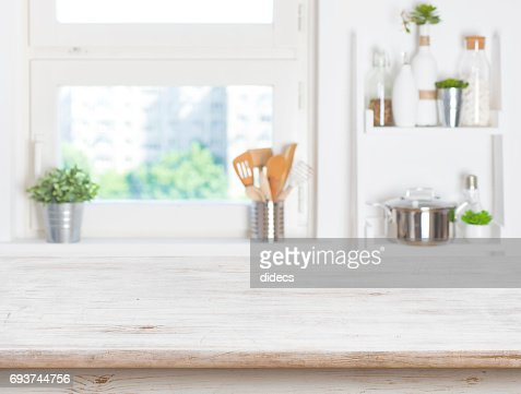 Empty table on blurred background of kitchen window and shelves : Stock Photo