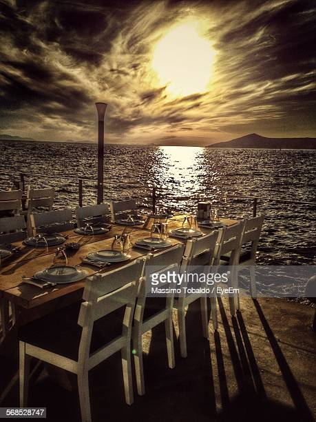 Empty Table Setting At Seaside During Sunset