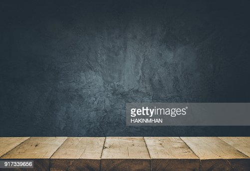 Empty table top with cement wall background. : Stock Photo