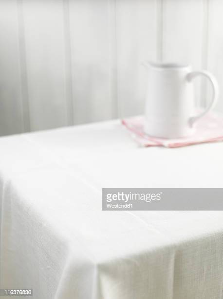 Empty table with pitcher