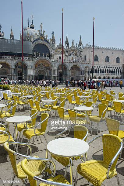 Empty tables and chairs at a cafe in St Mark's Square due to the heat on the day the Italian Government and Heath Ministry has issued several warning...