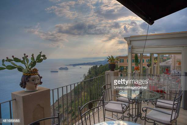 Empty tables and chairs at the restaurant on the terrace of a hotel Taormina Sicily Italy